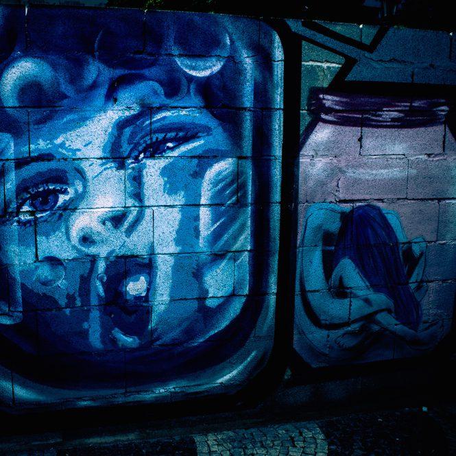 Graffiti of a woman in a bottle