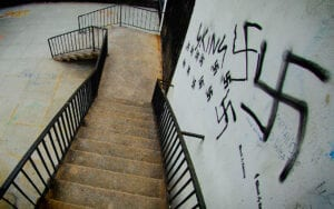 stairs with nazi symbol spraypainted on wall