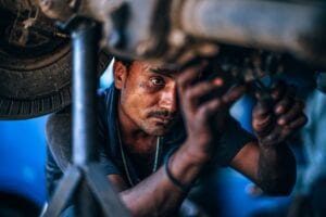 mechanic at work on a car