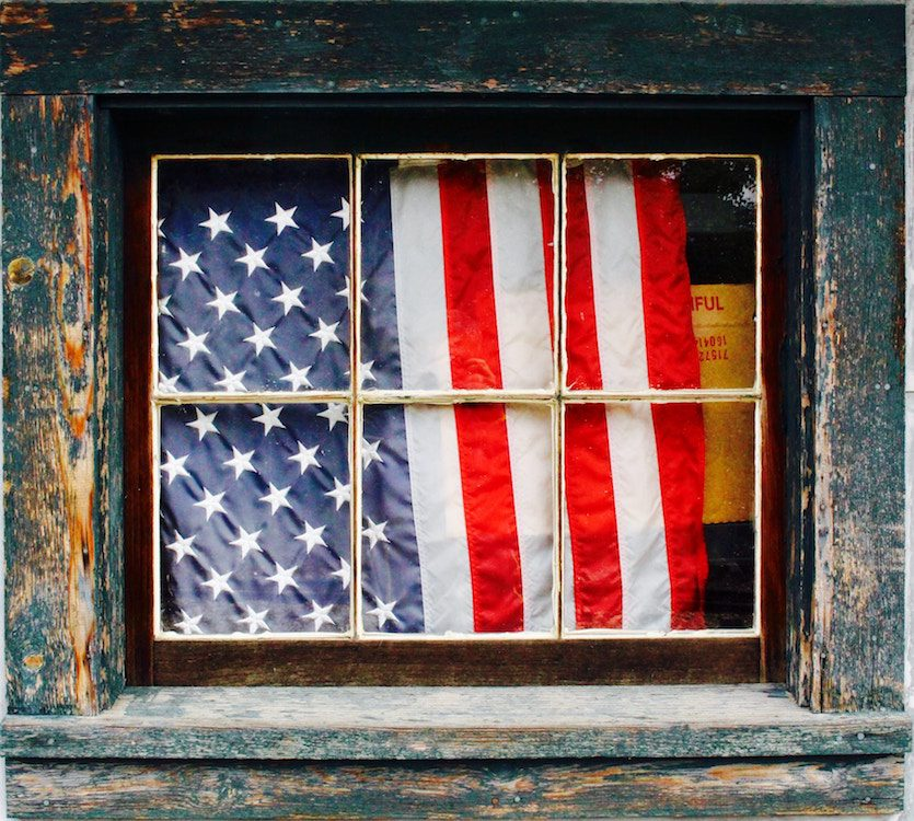 flag surrounded by a wooden window