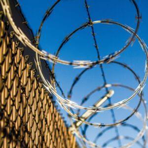 prisonexterior wall with razor wire