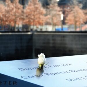 rose on a marker commemorating 9-11, World Trade Center