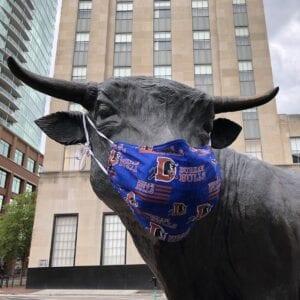 "Durham Bull statue, ""Major,"" wears a Durham Bull face mask"